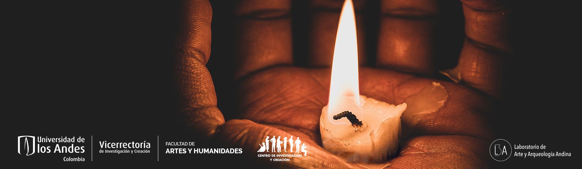 Mano abierta hacía arriba con pedazo de vela encendida en palma